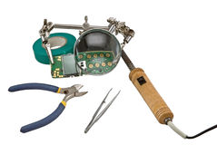 Magnifier and soldering iron Royalty Free Stock Image