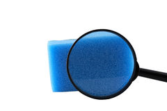 Magnifier and sponge for washing utensils Royalty Free Stock Photos