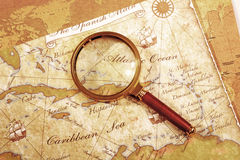 Magnifier on a Treasure map Stock Image