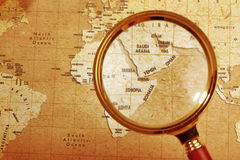 Magnifier on a Treasure map Royalty Free Stock Photography