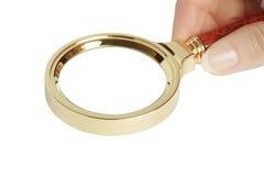 Magnifier in una mano femminile Fotografia Stock Libera da Diritti