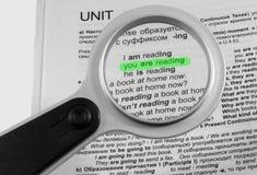 Magnifier voor lezing Stock Foto