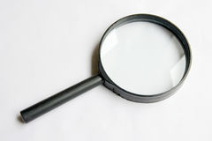 Magnifier on white background. A glass magnifier on the clean white background Stock Photos
