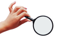 Magnifier and a woman hand. Magnifying glass and a woman hand Royalty Free Stock Image