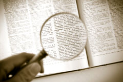 A magnifying glass on the word computer stock photo