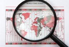 Magnifier on world map Royalty Free Stock Images