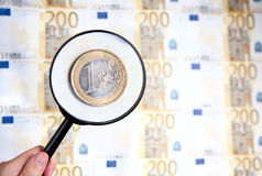 Magnifier zooming one euro Royalty Free Stock Photo