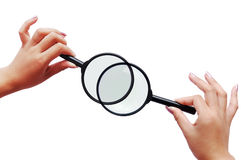 Magnifiers and two hands Royalty Free Stock Image