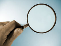 Magnify. Hand and magnifier stock image