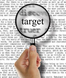 Magnify glass focus on target. Isolated on white blackboard Royalty Free Stock Images