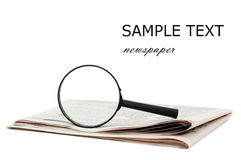 Magnify glass over a of newspaper Royalty Free Stock Image