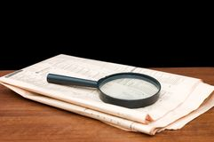 Magnify glass over a of newspaper Stock Image