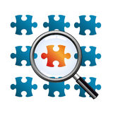 Magnify glass on red puzzle. Checking a puzzle with different colors Royalty Free Stock Photography