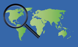 Magnify glass on a world map Stock Photography