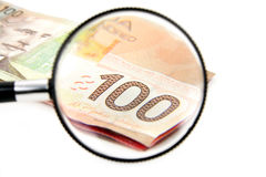 Magnifying a 100 canadian dollar Stock Photos
