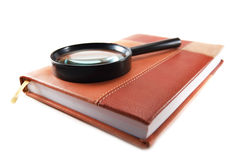 Magnifying. Business calendar and magnifying glass stock photo