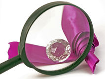 Magnifying and adornment with violet ribbon Stock Photography