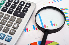 Magnifying and calculator Royalty Free Stock Photos