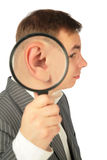 Magnifying ear. On a white Royalty Free Stock Photography