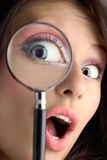 Magnifying eye Stock Image