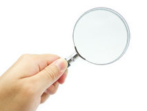 Magnifying Glass. And human hand royalty free stock images