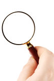 Magnifying Glass. Closeup Magnifying Glass with hand on the white background Stock Images