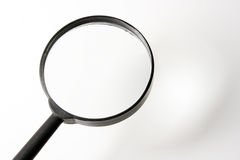 Magnifying glass. Put a small thing at shadow result enlarge at the surface of magnifying glass Royalty Free Stock Photo