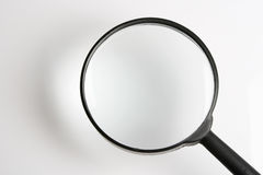 Magnifying    glass. Put a  small thing at shadow result  enlarge  at  the surface  of Stock Photo
