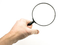 Magnifying glass. Hand holding a magnifying glass Stock Photo
