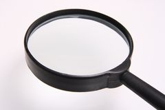 Magnifying    glass. Put a  small thing at shadow result  enlarge  at  the surface  of Royalty Free Stock Photos