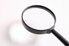 Magnifying glass. Put a small thing at shadow u get result enlarge at magnifying glass Stock Photos
