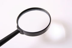 Magnifying    glass. Put a  small thing at shadow result  enlarge  at  the surface  of   magnifying glass Royalty Free Stock Photos