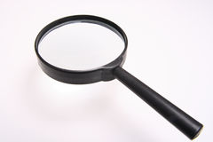 Magnifying glass. Put a small thing at down result enlarge at magnifying glass Stock Image