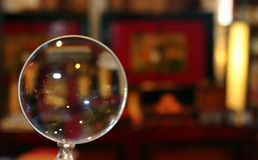 Magnifying Glass. A magnifying glass showing a store in the background Royalty Free Stock Photo