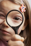Magnifying glass. Child holding a magnifying glass stock image