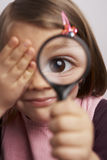 Magnifying glass. Child holding a magnifying glass royalty free stock images
