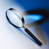 Magnifying glass. Black and chrome magnifying glass Royalty Free Stock Photo