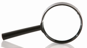 Magnifying glass. With reflection on white background Stock Images