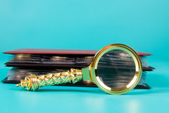 Magnifying glass and albums Royalty Free Stock Images