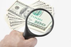 Magnifying Glass on the American Dollars Royalty Free Stock Photo