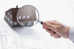 Magnifying Glass And House. Royalty Free Stock Images