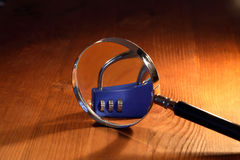 Magnifying Glass And Padlock Stock Photo