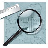 Magnifying glass on the architectural project Stock Images