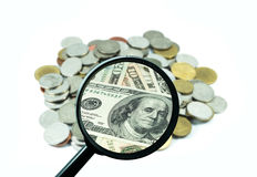 Magnifying glass with background of coins to be dollar, business Stock Photo