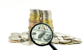 Magnifying glass with background of coins to be dollar, business concept Royalty Free Stock Photo