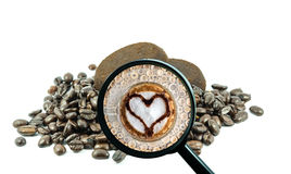 Magnifying glass with background of roasted coffee beans to be coffee cup Royalty Free Stock Photos