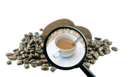 Magnifying glass with background of roasted coffee beans to be cup Stock Images
