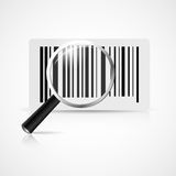 Magnifying glass with barcode Stock Photos