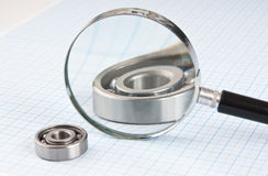 Magnifying glass and  bearing Royalty Free Stock Photo