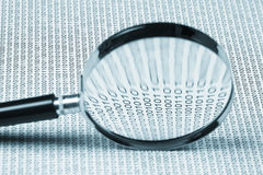 Magnifying glass on a binary code Royalty Free Stock Photo